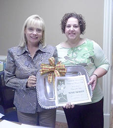 "<div class=""source""></div><div class=""image-desc"">Susie Skaggs, at left, from the Bertram, Cox & Miller law firm, receives this year's Citizen of the Year award.</div><div class=""buy-pic""></div>"