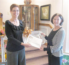 "<div class=""source""></div><div class=""image-desc"">Terri Cassell, at left, from Citizen's Bank and Trust Co., receives this year's Rita Goldstein Volunteer of the Year award.</div><div class=""buy-pic""></div>"