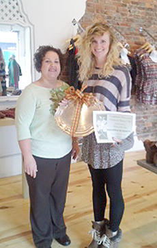 """<div class=""""source""""></div><div class=""""image-desc"""">Brianna Burden, at right, from Awaken Boutique, receives this year's Monday award. BPW honors a woman in the community for each day of National Business Women's Week, which was Oct. 8-12.</div><div class=""""buy-pic""""></div>"""