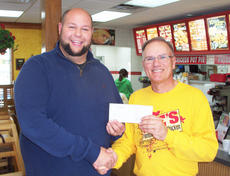 """<div class=""""source"""">Renee Dobson</div><div class=""""image-desc"""">Campbellsville High School Band director Zach Shelton recently received a check for $2,048 from Lee's Famous Recipe owner Dave Newton.</div><div class=""""buy-pic""""><a href=""""/photo_select/34105"""">Buy this photo</a></div>"""