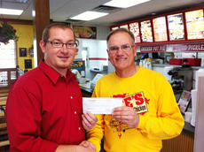 """<div class=""""source"""">Renee Dobson</div><div class=""""image-desc"""">Taylor County High School Band director Stephen Bishop recently received a check for $1,991 from Lee's Famous Recipe owner Dave Newton.</div><div class=""""buy-pic""""><a href=""""/photo_select/34106"""">Buy this photo</a></div>"""