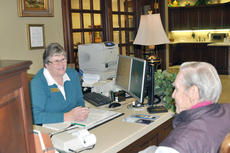 """<div class=""""source"""">Leslie Moore</div><div class=""""image-desc"""">Diane Hunt, head teller at Forcht Bank, helps customer Robert Oldham. Oldham said he enjoys the in-person service tellers provide versus ATMs. </div><div class=""""buy-pic""""><a href=""""http://web2.lcni5.com/cgi-bin/c2newbuyphoto.cgi?pub=085&orig=Banking%2B2.jpg"""" target=""""_new"""">Buy this photo</a></div>"""