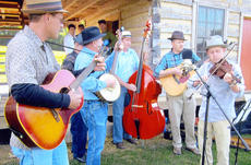 "<div class=""source""></div><div class=""image-desc"">The Exie Boys performed bluegrass music.</div><div class=""buy-pic""></div>"