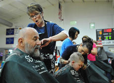 "<div class=""source"">Richard RoBards</div><div class=""image-desc"">Cathy Parish shaves Bob Beatty as Ethan Watkins is shaved by Tammy Wilson.  </div><div class=""buy-pic""></div>"