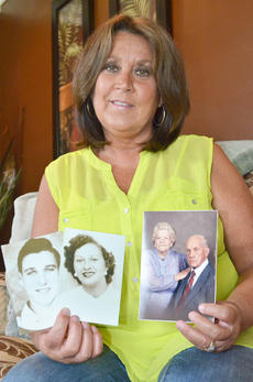 "<div class=""source"">Calen McKinney</div><div class=""image-desc"">Brenda Anderson, who was adopted at 3 months old, holds photos of her biological parents, at left, Harold Stewart and Beulah Rogers, and her adopted parents, Jesse and Minnie Carmicle. She said she has spent several years searching to find out her family history and truly believes being adopted saved her life.</div><div class=""buy-pic""><a href=""/photo_select/46150"">Buy this photo</a></div>"