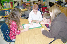 """<div class=""""source""""></div><div class=""""image-desc"""">Isabella Vannice, Christina Miller, Josh Lucas and Tuff Harper plan the different zones located within a classroom setting.</div><div class=""""buy-pic""""></div>"""