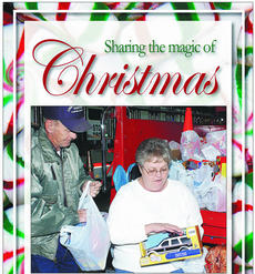"""<div class=""""source"""">James Roberts</div><div class=""""image-desc"""">Taylor County Fire Department volunteers Damon Sallee, left, and Sharon Dobson sort through bags of toys anonymously donated to the fire department's Toys for Kids program Monday morning.</div><div class=""""buy-pic""""><a href=""""/photo_select/20014"""">Buy this photo</a></div>"""