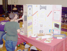 """<div class=""""source""""></div><div class=""""image-desc"""">Alexis Shears, Shayla Cain and Kaitlyn Clements discuss China.</div><div class=""""buy-pic""""></div>"""