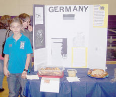 """<div class=""""source""""></div><div class=""""image-desc"""">Isaiah Campbell and other members of a group present about Germany.</div><div class=""""buy-pic""""></div>"""