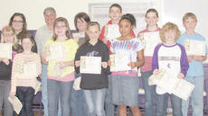 "<div class=""source""></div><div class=""image-desc"">Campbellsville Middle School winners are, front, from left, art winners Tahler Franklin, second place in school and classroom winner; Gracyne Hash, third place in school and classroom winner; Lauren Agathen, first place in school and classroom winner; writing winners Reagan Knight, classroom winner; Kayla Atkinson, classroom winner; and Jackson Hinton, third place in school and classroom winner. Back, Kayla Stockton, Samuel Kessler's teacher; Barry Smith Taylor County Conservation District supervisor; Donna White, Agathen's teacher; Murphy Lamb, classroom winner; Blair Lamb, second place in school and classroom winner; and Peyton Reynolds, classroom winner.</div><div class=""buy-pic""></div>"