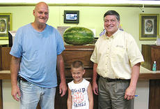 "<div class=""source""></div><div class=""image-desc"">Bradley Tucker, left, is the winner of last week's Community Trust Bank Guess the Weight contest. Tucker correctly guessed the weight of a watermelon at the bank's Broadway office. Barry Pennington, Community Trust Bank senior loan officer, presented Tucker with a watermelon.</div><div class=""buy-pic""></div>"