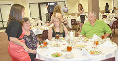"""<div class=""""source"""">Joan C. McKinney</div><div class=""""image-desc"""">Lauren Goodin, left, an admissions counselor from Columbia, talks with Sheila Wilson, left, and her husband, Brian, who were at the Central Kentucky Scholars' Day dinner with their daughter, Emily, center.</div><div class=""""buy-pic""""></div>"""