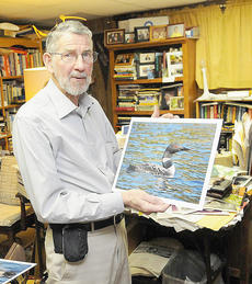 "<div class=""source"">Richard RoBards</div><div class=""image-desc"">Dr. Robert Doty holds a bird photo that will be in his exhibit at Campbellsville University March 19-30. </div><div class=""buy-pic""></div>"