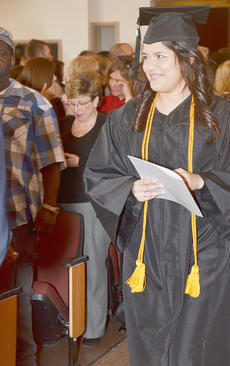 """<div class=""""source"""">Joan C. McKinney</div><div class=""""image-desc"""">Barbara De Queiroz of Campbellsville walks into Ransdell Chapel during commencement. She received a bachelor of science in business administration degree in marketing.</div><div class=""""buy-pic""""><a href=""""/photo_select/41806"""">Buy this photo</a></div>"""