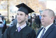 """<div class=""""source"""">Ye Wei """"Vicky""""</div><div class=""""image-desc"""">Tyler Hardy and his dad, Jim Hardy, CU assistant football coach, talk after Campbellsville University's commencement. Hardy received a bachelor of science degree in middle grades education.</div><div class=""""buy-pic""""><a href=""""/photo_select/41807"""">Buy this photo</a></div>"""
