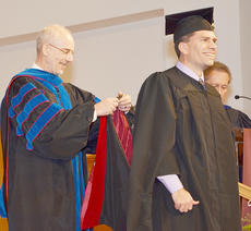 """<div class=""""source"""">Joan C. McKinney</div><div class=""""image-desc"""">Matt Flanagan of Bardstown, the son of Dan and Ginny Flanagan of Campbellsville, receives his master of theology hood from Dr. John Hurtgen, dean of the School of Theology, at the Campbellsville University commencement program in Ransdell Chapel. </div><div class=""""buy-pic""""><a href=""""/photo_select/41809"""">Buy this photo</a></div>"""