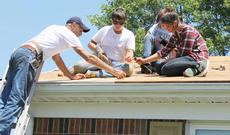 """<div class=""""source"""">Lauren Barr</div><div class=""""image-desc"""">Volunteers began repairing the roof at a home in Campbellsville during KHO's Summer Repair Program. From left are Frank Fersch of East Newnan Baptist Church in Newnan, Ga., Zach Crewse with Orange United Methodist Church in Chapel Hill, N.C., Chandler Riggs with Hillside United Methodist Church in Woodstock, Ga. and Jade Rouse with East Newnan Baptist Church in Newnan, Ga. Their crew leader, not pictured, is Chris Barton, a CU alumnus.</div><div class=""""buy-pic""""></div>"""