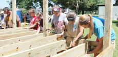 """<div class=""""source"""">Lauren Barr</div><div class=""""image-desc"""">Volunteers begin assembling a deck for a homeowner in Campbellsville, who had an unsafe entrance on his home before the crew arrived. From left are Paige Oakley with Wellspring Community Church in Liberty Township, Ohio, Kelsey Phelps, Carley Johnson, Jaley Broughton and Peyton Ingram, all with Eubank Baptist Church in Eubank.</div><div class=""""buy-pic""""></div>"""