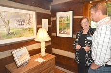 "<div class=""source"">Joan C. McKinney</div><div class=""image-desc"">Artist Cora Renfro, left, shows Chris Reynolds of Campbellsville some of the artwork at the Campbellsville University Log Cabin Art Shop.</div><div class=""buy-pic""></div>"