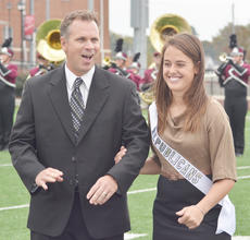 """<div class=""""source"""">Calen McKinney</div><div class=""""image-desc"""">Emily Shultz, a senior from Mt. Sterling, was named this year's Homecoming queen during halftime of the game against Lindsey Wilson College. Shultz, a political science and history major and captain of the women's soccer team, represented College Republicans. She was escorted by her coach, Thom Jones.</div><div class=""""buy-pic""""><a href=""""/photo_select/40789"""">Buy this photo</a></div>"""