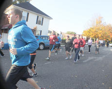 """<div class=""""source""""></div><div class=""""image-desc"""">Walkers and runners prepare for the start of the race.</div><div class=""""buy-pic""""></div>"""