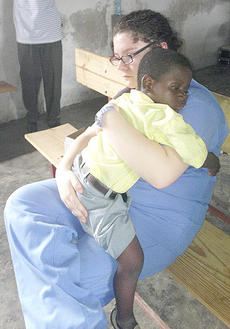 """<div class=""""source""""></div><div class=""""image-desc"""">Lauren Barr, a sophomore nursing student from Brandenburg, holds an orphan named Dave in Haiti. Dave is sick and needs surgery so Barr gave him what she could - love.</div><div class=""""buy-pic""""></div>"""