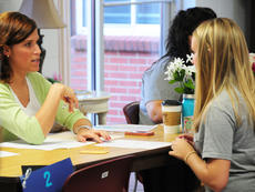 """<div class=""""source"""">Drew Tucker</div><div class=""""image-desc"""">Erin Johnson, resident director, helps a freshman with paperwork before moving into her dorm room.</div><div class=""""buy-pic""""><a href=""""http://web2.lcni5.com/cgi-bin/c2newbuyphoto.cgi?pub=085&orig=CU%2BStudents%2BMove%2BCounselor2%2BColor.jpg"""" target=""""_new"""">Buy this photo</a></div>"""