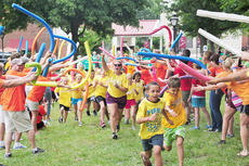"""<div class=""""source"""">Drew Tucker</div><div class=""""image-desc"""">These children participate in """"Mass Chaos"""" at a CentriKid camp at Campbellsville University. More than 7,000 people will participate in camps at CU during the summer.</div><div class=""""buy-pic""""></div>"""