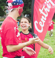 """<div class=""""source"""">Drew Tucker</div><div class=""""image-desc"""">Jaide Jones of First Baptist Church in Murphysboro, Ill., plays a game with a CentriKid leader Caleb McDonald of First Baptist Church in Shelbyville on the campus of Campbellsville University. There will be eight different sessions of CentriKid on CU's campus this summer.</div><div class=""""buy-pic""""></div>"""