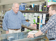 "<div class=""source"">Calen McKinney</div><div class=""image-desc"">Bill Chandler, owner of Chandler's Office Supply, talks with employee Paul Gilbert. Campbellsville/Taylor County Chamber of Commerce members recently voted Chandler's business as Business of the Year. </div><div class=""buy-pic""><a href=""http://web2.lcni5.com/cgi-bin/c2newbuyphoto.cgi?pub=085&orig=Chandler%2527s%2B2.jpg"" target=""_new"">Buy this photo</a></div>"