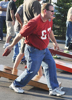 "<div class=""source"">James Roberts</div><div class=""image-desc"">Freddie Cook participates in the corn hole tournament.</div><div class=""buy-pic""><a href=""/photo_select/33128"">Buy this photo</a></div>"