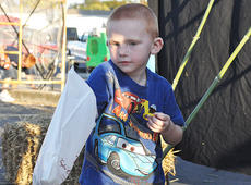 "<div class=""source"">James Roberts</div><div class=""image-desc"">Landen Grijalva, 3, digs for his prizes after trying his luck at the fish pond.</div><div class=""buy-pic""><a href=""/photo_select/33117"">Buy this photo</a></div>"