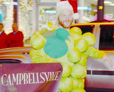 """<div class=""""source"""">Calen McKinney</div><div class=""""image-desc"""">Campbellsville resident Andrew Ward dresses as a grape while representing Vineyard Campbellsville in the parade.</div><div class=""""buy-pic""""><a href=""""/photo_select/41656"""">Buy this photo</a></div>"""