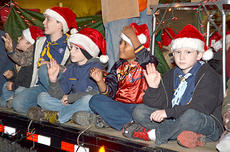 """<div class=""""source"""">Calen McKinney</div><div class=""""image-desc"""">Cub Scout Pack 777 members wave to the crowd.</div><div class=""""buy-pic""""><a href=""""/photo_select/41657"""">Buy this photo</a></div>"""