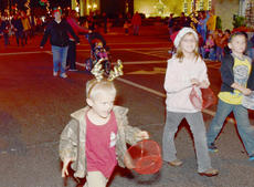 """<div class=""""source"""">Calen McKinney</div><div class=""""image-desc"""">Many Campbellsville children wear Christmas gear while participating in this year's parade.</div><div class=""""buy-pic""""><a href=""""/photo_select/41658"""">Buy this photo</a></div>"""