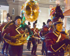 """<div class=""""source"""">Calen McKinney</div><div class=""""image-desc"""">Campbellsville University Tiger Marching Band members decorate their instruments for the parade.</div><div class=""""buy-pic""""><a href=""""/photo_select/41659"""">Buy this photo</a></div>"""