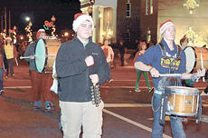 """<div class=""""source"""">Calen McKinney</div><div class=""""image-desc"""">Taylor County High School Marching Band members decorate their instruments and dress in Christmas gear for the parade.</div><div class=""""buy-pic""""><a href=""""/photo_select/41663"""">Buy this photo</a></div>"""