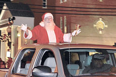 """<div class=""""source"""">Calen McKinney</div><div class=""""image-desc"""">Santa makes an appearance in Campbellsville on Saturday as the grand marshal of this year's Christmas parade.</div><div class=""""buy-pic""""><a href=""""/photo_select/41664"""">Buy this photo</a></div>"""