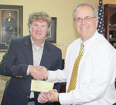 "<div class=""source""></div><div class=""image-desc"">Campbellsville Mayor Tony Young accepts the grant from Joseph Isaacs of the Kentucky League of Cities.</div><div class=""buy-pic""></div>"
