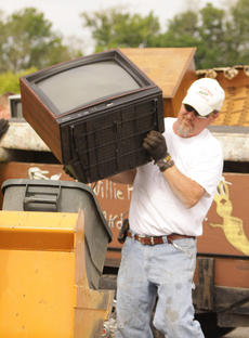 """<div class=""""source"""">Jeff Moreland</div><div class=""""image-desc"""">Harold Wethington, a Taylor County employee, unloads a TV from a trailer during the Clean Taylor County event Friday.</div><div class=""""buy-pic""""><a href=""""http://web2.lcni5.com/cgi-bin/c2newbuyphoto.cgi?pub=085&orig=Cleanup%2B2.jpg"""" target=""""_new"""">Buy this photo</a></div>"""