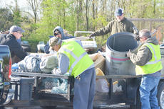 """<div class=""""source"""">Calen McKinney</div><div class=""""image-desc"""">County road department employees, above, and Taylor County Detention Center inmates help unload items.</div><div class=""""buy-pic""""><a href=""""http://web2.lcni5.com/cgi-bin/c2newbuyphoto.cgi?pub=085&orig=Cleanup%2B4.jpg"""" target=""""_new"""">Buy this photo</a></div>"""