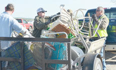 """<div class=""""source"""">Calen McKinney</div><div class=""""image-desc"""">County road department employees, above, and Taylor County Detention Center inmates help unload items.</div><div class=""""buy-pic""""><a href=""""http://web2.lcni5.com/cgi-bin/c2newbuyphoto.cgi?pub=085&orig=Cleanup%2B5.jpg"""" target=""""_new"""">Buy this photo</a></div>"""