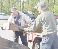 """<div class=""""source"""">Calen McKinney</div><div class=""""image-desc"""">County Road Department employees Gary Hunt, at left, and Doug Godsey help unload items at Friday's cleanup.</div><div class=""""buy-pic""""><a href=""""http://web2.lcni5.com/cgi-bin/c2newbuyphoto.cgi?pub=085&orig=Cleanup%2B6.jpg"""" target=""""_new"""">Buy this photo</a></div>"""