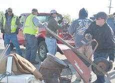 """<div class=""""source"""">Calen McKinney</div><div class=""""image-desc"""">County road department employees, above, and Taylor County Detention Center inmates help unload items.</div><div class=""""buy-pic""""><a href=""""http://web2.lcni5.com/cgi-bin/c2newbuyphoto.cgi?pub=085&orig=Cleanup%2B7.jpg"""" target=""""_new"""">Buy this photo</a></div>"""