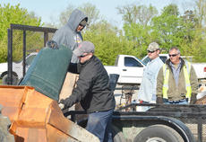 """<div class=""""source"""">Calen McKinney</div><div class=""""image-desc"""">County road department employees, above, and Taylor County Detention Center inmates help unload items.</div><div class=""""buy-pic""""><a href=""""http://web2.lcni5.com/cgi-bin/c2newbuyphoto.cgi?pub=085&orig=Cleanup%2B8.jpg"""" target=""""_new"""">Buy this photo</a></div>"""