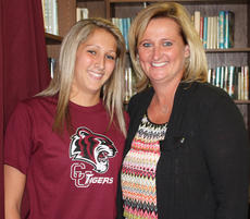 "<div class=""source"">Campbellsville University</div><div class=""image-desc"">Madison Clements, left, like her future coach Campbellsville University's Ginger Colvin, at right, will be a Lady Tiger after playing at Monroe County High.</div><div class=""buy-pic""></div>"