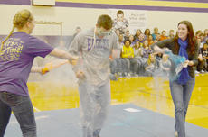 """<div class=""""source"""">Calen McKinney</div><div class=""""image-desc"""">Weston Jones, a physical education teacher at Campbellsville Middle School, is """"splashed"""" with color to demonstrate what will happen during the Color to Conquer fundraising 5K run and walk on Saturday, March 16. The event will raise money for this year's St. Baldrick's fundraiser to fund children's cancer research. St. Baldrick's annual shaving event is Saturday, March 23. </div><div class=""""buy-pic""""><a href=""""/photo_select/42892"""">Buy this photo</a></div>"""