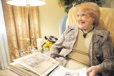 """<div class=""""source"""">Andre Tomaz</div><div class=""""image-desc"""">Jeanette Conner looks through a scrapbook at her home.</div><div class=""""buy-pic""""></div>"""