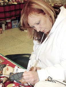 """<div class=""""source"""">James Roberts</div><div class=""""image-desc"""">At right, Becky Hadley puts the finishing touches on a handmade Christmas ornament at her booth.</div><div class=""""buy-pic""""><a href=""""http://web2.lcni5.com/cgi-bin/c2newbuyphoto.cgi?pub=085&orig=Craft%2Bshow_0016.jpg"""" target=""""_new"""">Buy this photo</a></div>"""