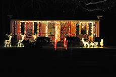 """<div class=""""source"""">James Roberts</div><div class=""""image-desc"""">This is a view of Tom Curry's Christmas decorations after dark.</div><div class=""""buy-pic""""><a href=""""/photo_select/34603"""">Buy this photo</a></div>"""